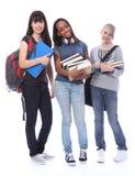 Gelukkige tiener etnische studentenmeisjes in onderwijs stock foto's