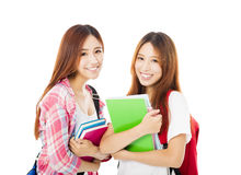 Gelukkige tienerdiestudentenmeisjes op wit worden geïsoleerd Royalty-vrije Stock Foto's