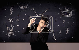 Gelukkige TV van de zakenmantekening en radio Royalty-vrije Stock Foto's
