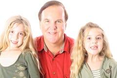 Gelukkige tweelingen met oom Royalty-vrije Stock Afbeelding