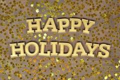 Gelukkige vakantie gouden tekst en gouden sterren Stock Afbeelding