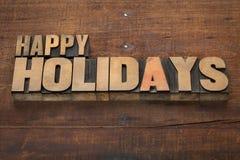Gelukkige vakantie in houten type Stock Foto