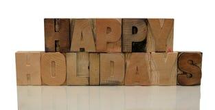 Gelukkige vakantie in letterzetsel houten type Royalty-vrije Stock Afbeeldingen