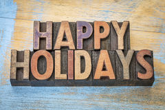 Gelukkige vakantie in letterzetsel houten type Stock Foto