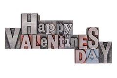 Gelukkige Valentijnskaartendag in oud die metaalletterzetsel op wit wordt geïsoleerd Stock Fotografie