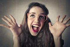 Gelukkige verraste jonge vrouw stock foto's