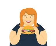 Gelukkige vette vrouw die een grote hamburger eten Royalty-vrije Stock Foto's