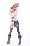 gelukkige vrouw in de winterkleren op wit BG Royalty-vrije Stock Foto's