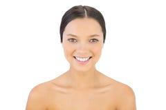 Gelukkige vrouw die bij camera glimlachen Royalty-vrije Stock Foto