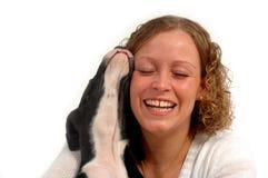 Gelukkige vrouw en hond royalty-vrije stock afbeelding