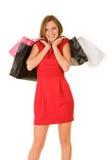 Gelukkige vrouw met aankoopzakken Stock Fotografie