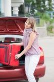 Gelukkige vrouw met bagage Royalty-vrije Stock Fotografie