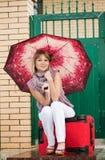 Gelukkige vrouw met bagage Royalty-vrije Stock Afbeeldingen