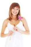 Gelukkige vrouw met bloem Stock Foto's