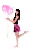 Gelukkige vrouw met drie roze ballons Royalty-vrije Stock Fotografie