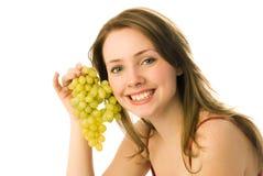 Gelukkige vrouw met druiven royalty-vrije stock afbeelding