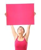 Gelukkige vrouw met een banner Stock Foto's