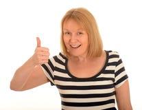 Gelukkige vrouw met een omhoog duim Royalty-vrije Stock Afbeeldingen