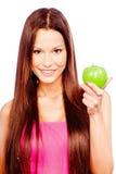 Gelukkige vrouw met groene appel stock foto