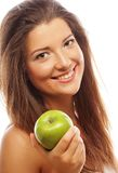 Gelukkige vrouw met groene appel stock afbeeldingen
