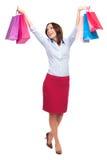 Gelukkige vrouw met het winkelen zakken stock afbeelding
