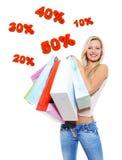 Gelukkige vrouw met het winkelen zakken Royalty-vrije Stock Foto's