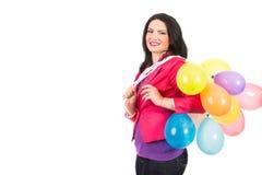 Gelukkige vrouw met kleurrijke ballons Stock Foto's