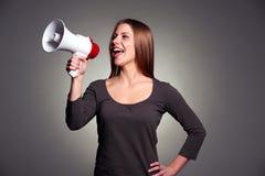 Gelukkige vrouw met luidspreker Stock Afbeeldingen