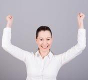 Gelukkige vrouw met omhoog duimen stock foto
