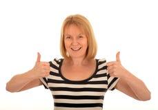 Gelukkige Vrouw met omhoog Duimen Royalty-vrije Stock Afbeeldingen