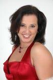 Gelukkige Vrouw in Rood stock afbeelding