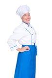 Gelukkige vrouwelijke kok in eenvormig Stock Afbeeldingen