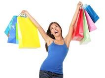 Gelukkige winkelende vrouw Stock Foto's