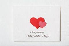 Gelukkige witte het berichtkaart van de Moedersdag met harten stock fotografie