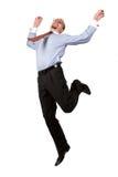 Gelukkige zakenman die in de lucht springt Stock Foto