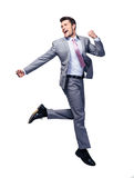 Gelukkige zakenman die over witte achtergrond lopen stock foto