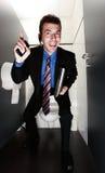 Gelukkige zakenman die zich in toilet bevindt Royalty-vrije Stock Afbeeldingen