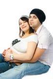 Gelukkige zwangere vrouw en haar echtgenoot Stock Foto's