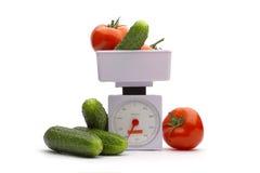 Gemüse auf Gewichten Stockfotos