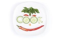 Gemüse in Form von Buchstaben auf einer Platte Lizenzfreies Stockfoto