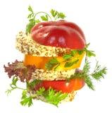 Gemüse schiebt mit Tomate- und Pfefferscheiben ein Stockbilder