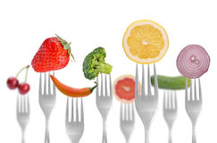 Früchte auf Gabeln lizenzfreie stockfotografie