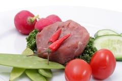 Gemüse und rohes Fleisch Stockbilder