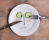 Gemüsegesicht auf Platte - Mann, unglücklich Stockfotos