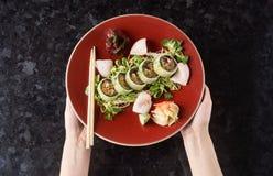 Gemüsesushirollen mit Fischen Lizenzfreies Stockfoto