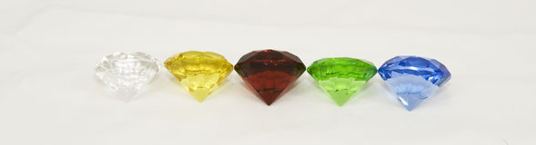 Gem lineup. A row of various rare gems and jewels royalty free stock image