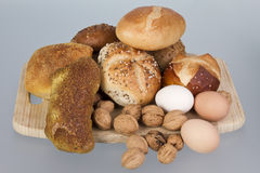 Gem, nuts and eggs on a wooden board Stock Photography