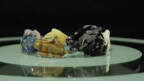 Gem stone carving rabbits rotate stock footage