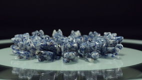 Gem stone carving rats rotate stock footage