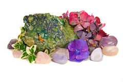 Gem stones and blossoms. Semi precious stones with autumnal decoration Stock Image